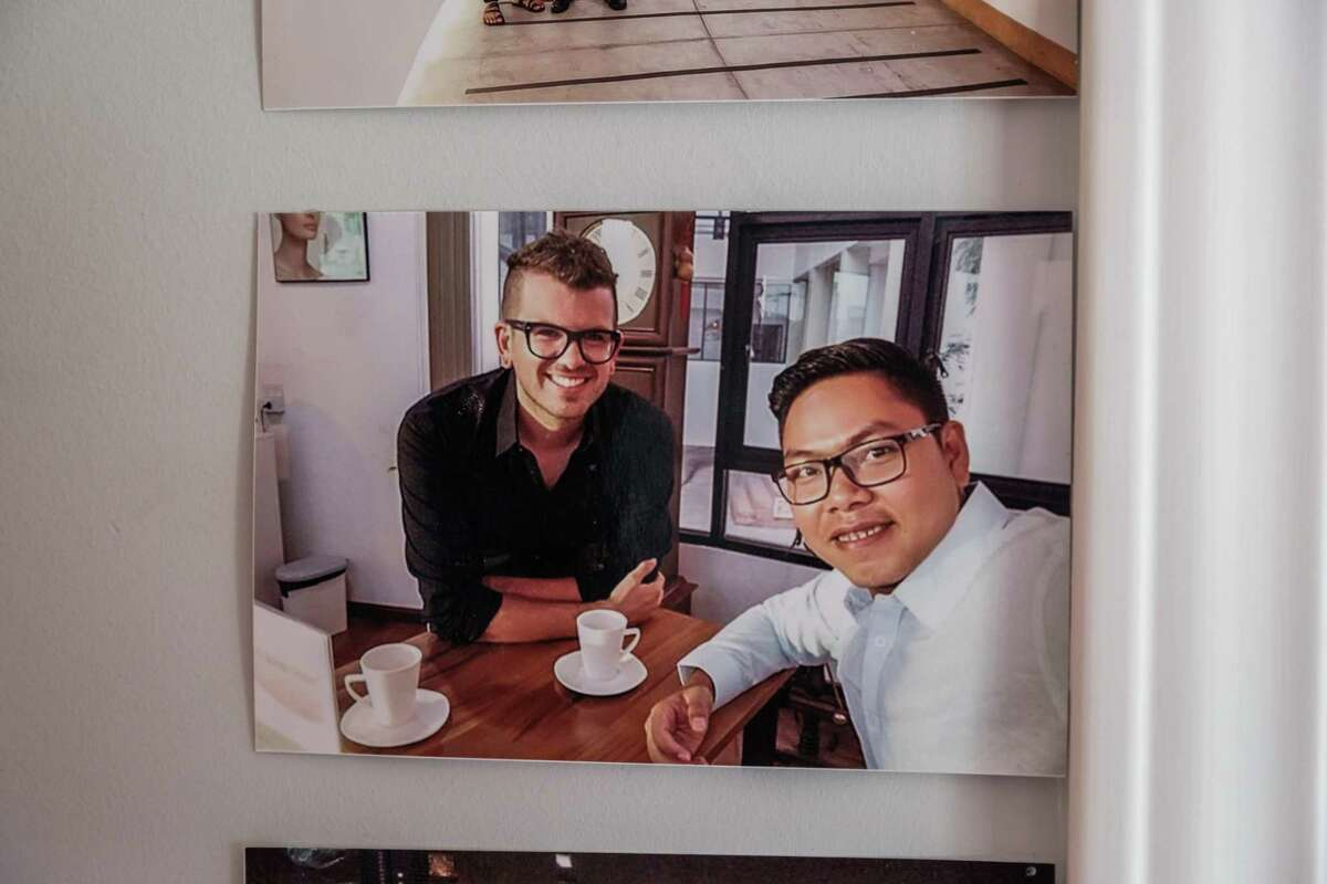 A photograph of Kenny Kruse and his fiance Yar Zar Min hangs on the wall of Kruse's home in San Francisco on Friday, Feb. 12, 2021. Yar Zar Min is currently in Myanmar, the site of a recent military coup. The logistics for him to get to San Francisco have now become much more complicated.