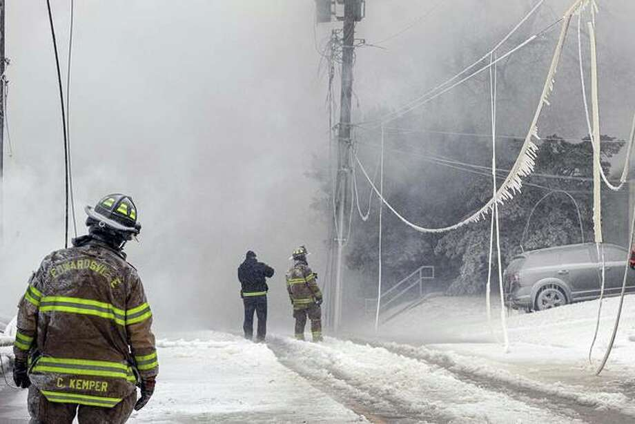 Water from the firefighters' hoses froze on everything in the vicinity of the fire as supporting fire teams strove to keep the wind-driven flames from claiming houses across the street from the lumberyard. Photo: Luke Whalen | For The Intelligencer