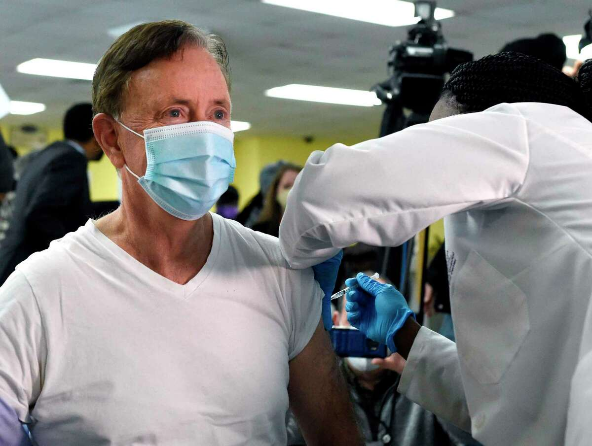 Connecticut Gov. Ned Lamont receives his first dose of Pfizer's COVID-19 vaccine at The First Cathedral church Tuesday, Feb. 16, 2021, in Bloomfield.