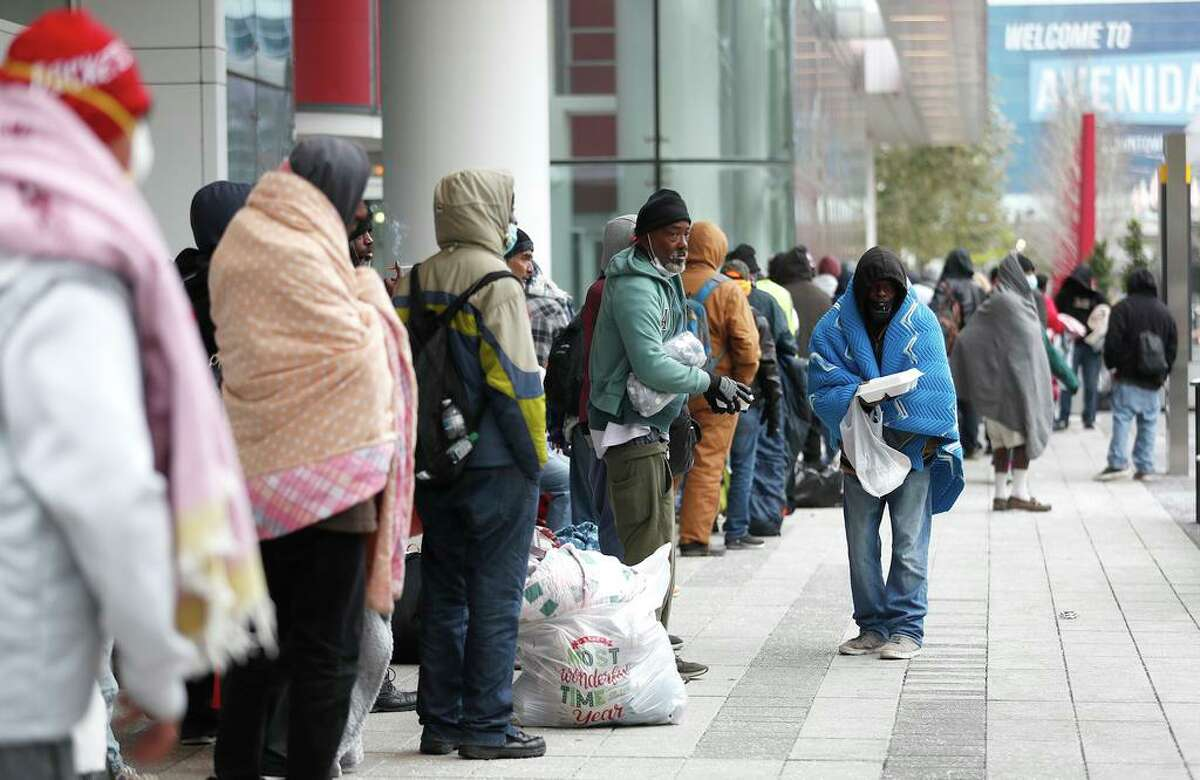 A line of more than 200 people formed outside at the George R. Brown Convention Center, which city officials opened as an emergency shelter for the area homeless, who needed to get out of the freezing temperatures.