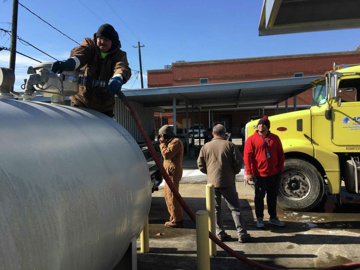 South Houston employees watch as a fuel tank at the city police department gets refilled. At one point, officials worried they might not be able to get fuel to run infrastructure for critical services, including the small city's police station and waste treatment station, Tuesday, Feb. 16, 2021.