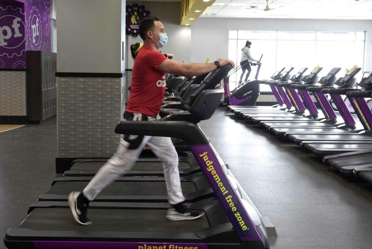 Oscar Vegas, of Danbury, uses a treadmill at Planet Fitness on Thursday morning, February 11, 2021, in Danbury, Conn