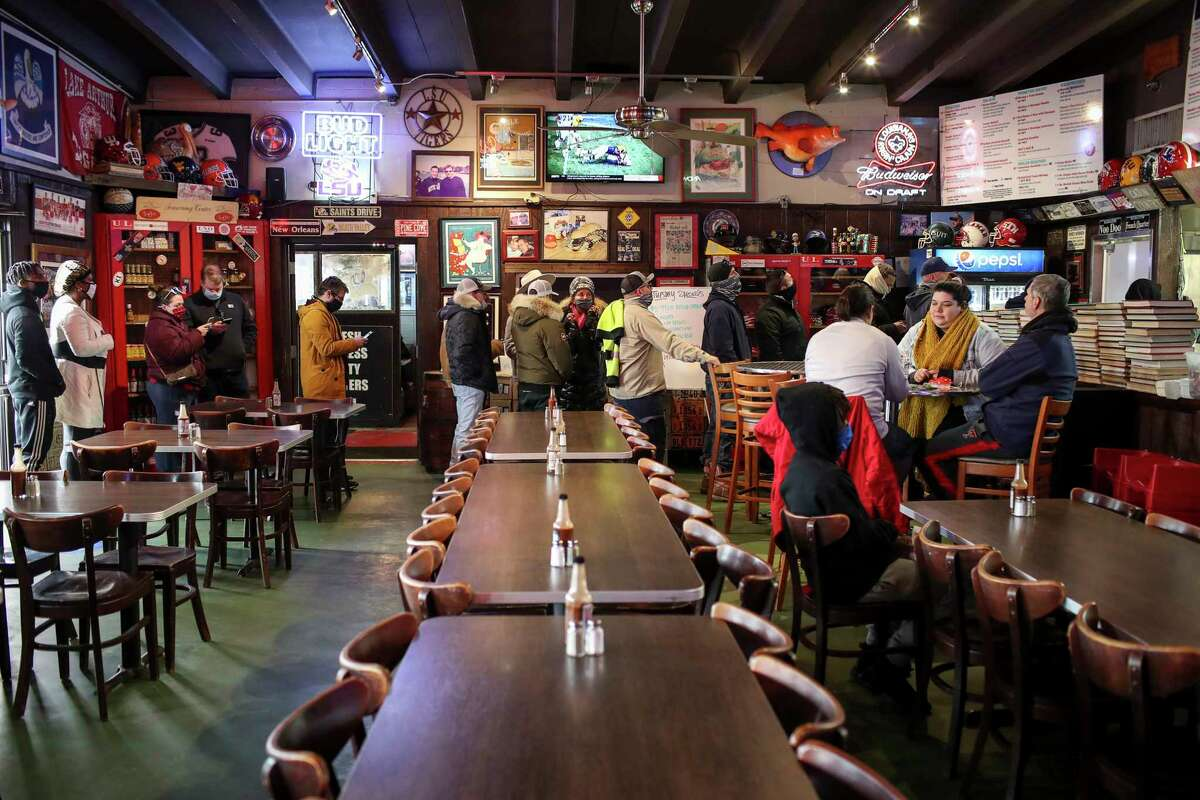 People wait to order food Tuesday, Feb. 16, 2021, at Ragin' Cajun in Houston.