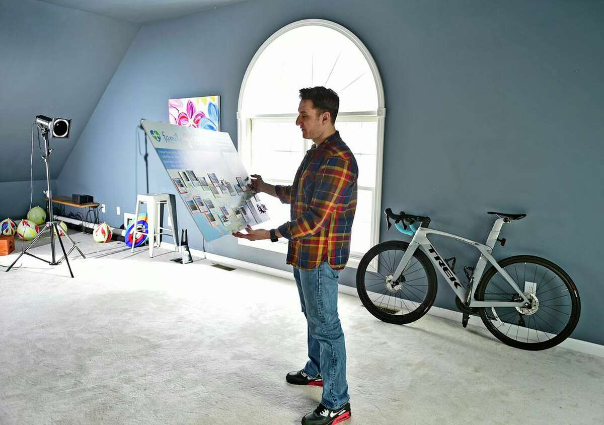 Photographer Noah Ehlert, of Guilford, looking at a diorama of his bike journey to California Family Recources' SAfePlace2B shelter, where he lived as an 11-year-old runaway, returning to share his story while inspiring homeless children there and at other youth shelters to discover their path to success. He wanted to bring message of hope that they can achieve their dreams. Founder, Discover Your Path, Inc.