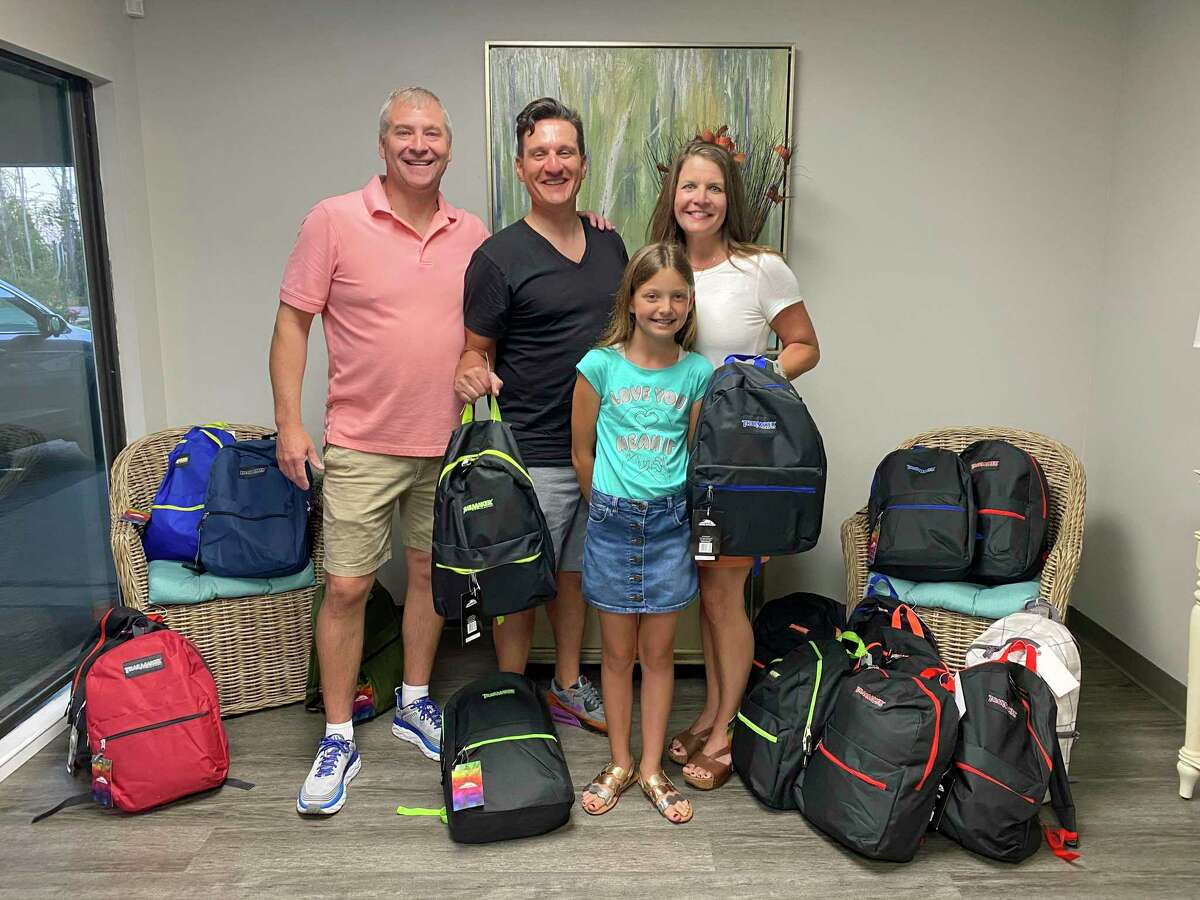 Giving out Comfort Cases at Anchorage Children's Home in Panama City, Fla., with Joel Booth and Brooke Bullard.