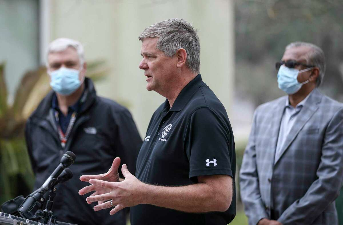 Galveston County Judge Mark Henry, center, speaks during a press conference about mass vaccination efforts for Galveston County as Dr. Philip Keiser, left, the local health authority, and Dr. Janak Patel, right, co-chair of the Vaccine Preparedness Task Force, listen Wednesday, Jan. 20, 2021, at Walter Hall Park in League City.
