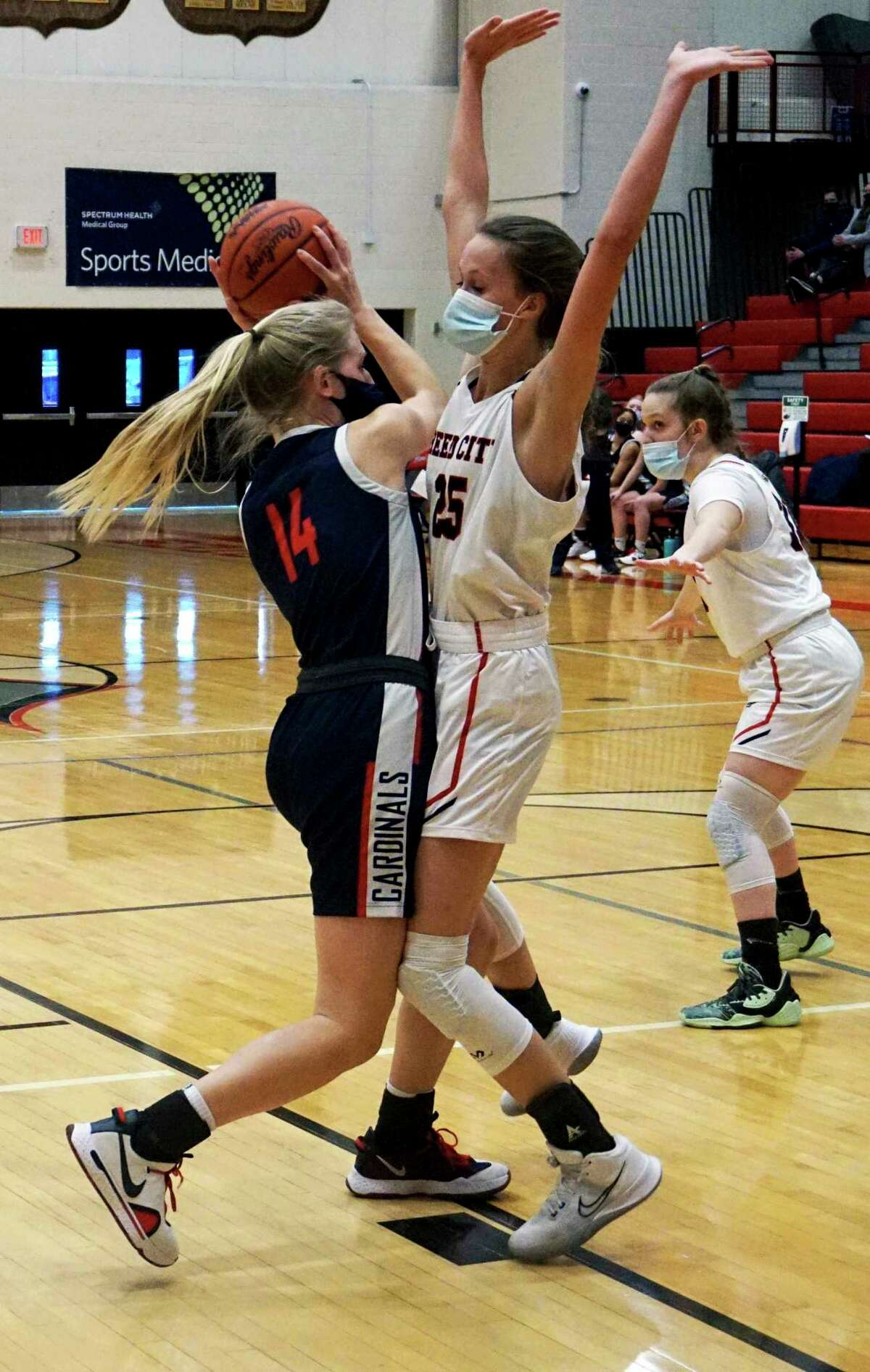 Junior Makenna Rautio, of Big Rapids, attacks the lane as Reed City freshman Kyleigh Weck guards her during Tuesday night's basketball game. (Pioneer photo/Joe Judd)