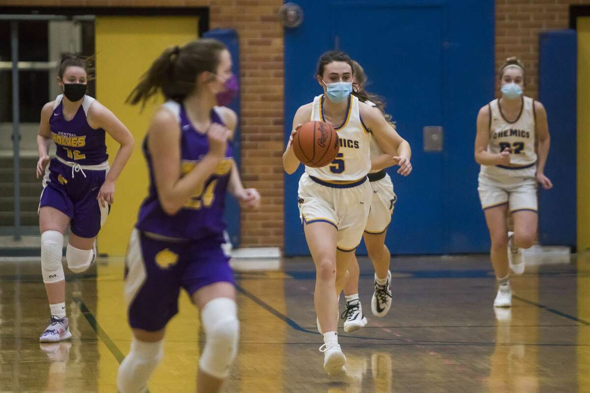 Midland's Olivia Carpenter dribbles down the court during the Chemics' game against Bay City Central Tuesday, Feb. 16, 2021 at Midland High School. (Katy Kildee/kkildee@mdn.net)