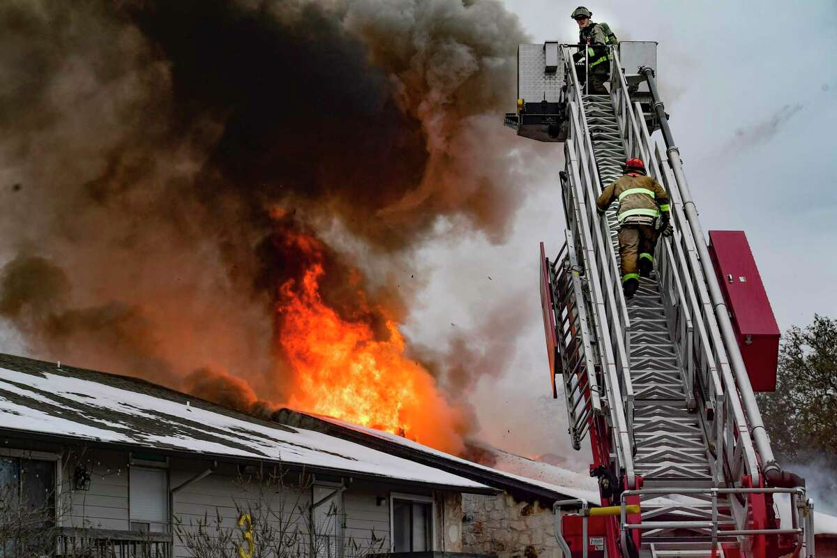 Firefighters battle a blaze at an apartment complex near the intersection of West Avenue and West Silver Sands Drive on Tuesday, Feb. 16, 2021 Residents of the complex said that electric power had been out most of the day because of the snow and cold weather.