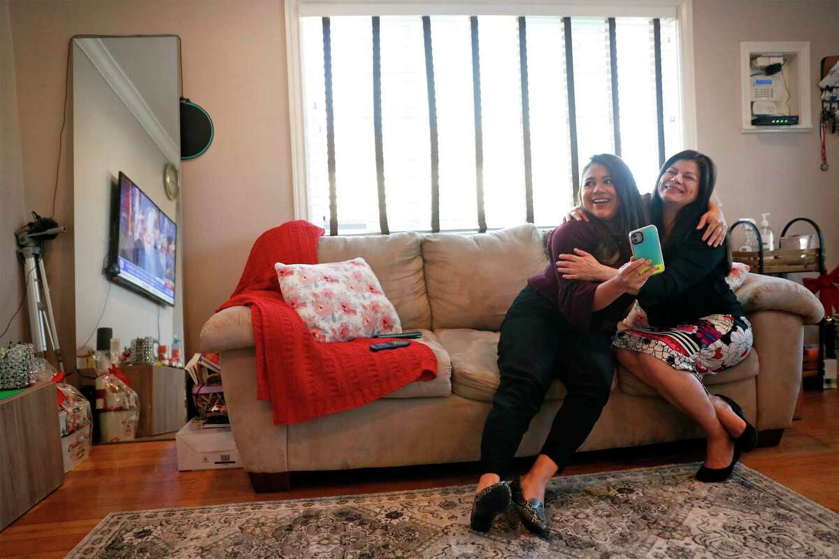 DACA recipient Vanessa Mejia and her mother, Connie, watch from their living room in Oakland, Calif., as Joe Biden takes the oath of office at the U.S. Capitol in Washington, D.C. on Wednesday, Jan. 20, 2021.
