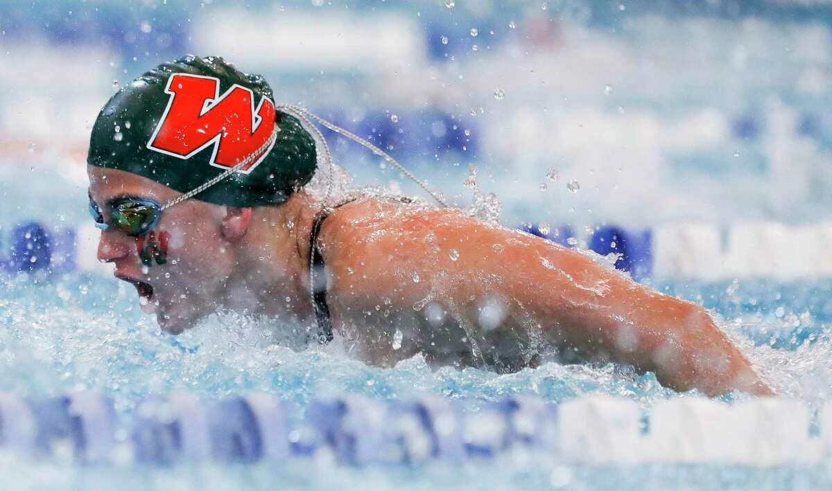 FILE - Paige Taber of The Woodlands competes in the girls 200-yard individual medley during the Region IV-6A Swimming & Diving Championships at the Conroe ISD Natatorium, Friday, Feb. 5, 2020, in Shenandoah.