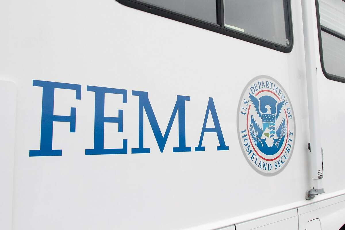 A FEMA (Federal Emergency Management Authority) trailer sits at the COVID-19 mass vaccination site opened to the public at the Oakland-Alameda Coliseum Complex in Oakland, Calif. on Feb. 16, 2021. The trailer will travel to low income communities in the Bay Area to deliver vaccine shots. The vehicles will be able to administer 250 vaccine shots at a time.