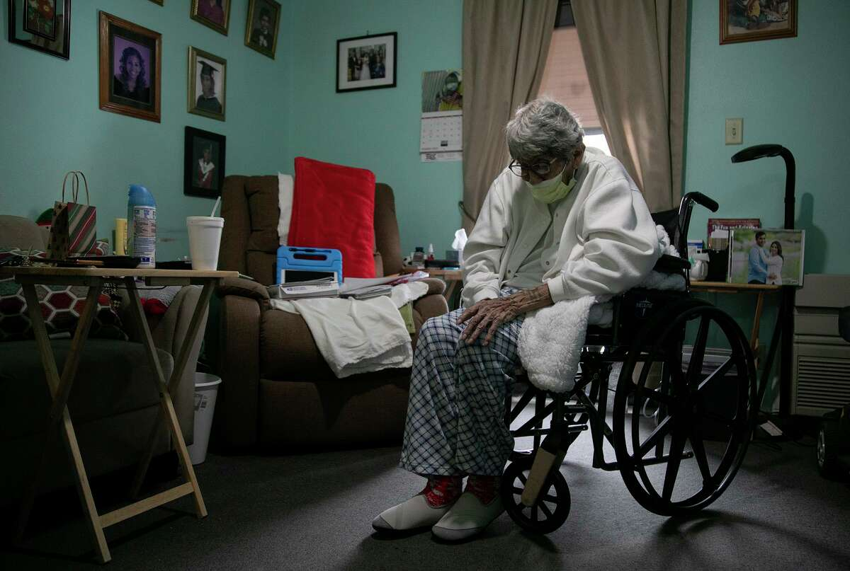 Herminia Rodriguez, 85, sits in her apartment at the Ernest C. Olivares Senior Community Residence shortly after electricity returned to the apartments in San Antonio on Feb. 16, 2021.
