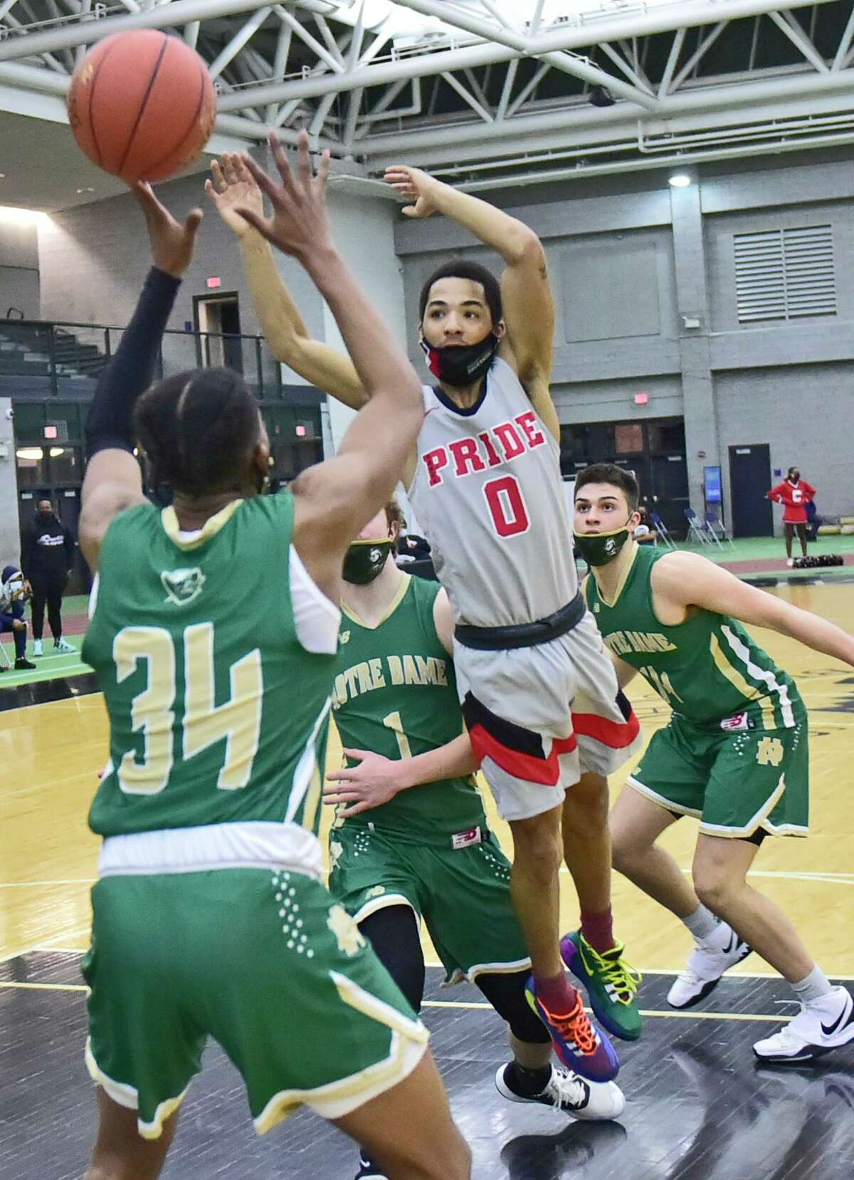 Wilbur Cross' Dereyk Grant drives to the basket against Notre Dame-West Haven during the first quarter at the Floyd Little Athletic Center in New Haven on Tuesday.