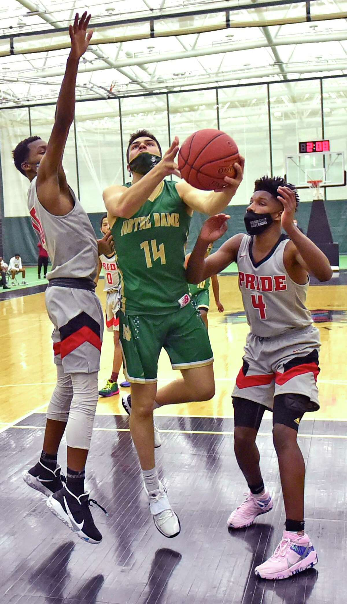 Notre Dame-West Haven's Matthew Dobie drives to the basket against Wilbur Cross during the second quarter at the Floyd Little Athletic Center in New Haven on Tuesday.