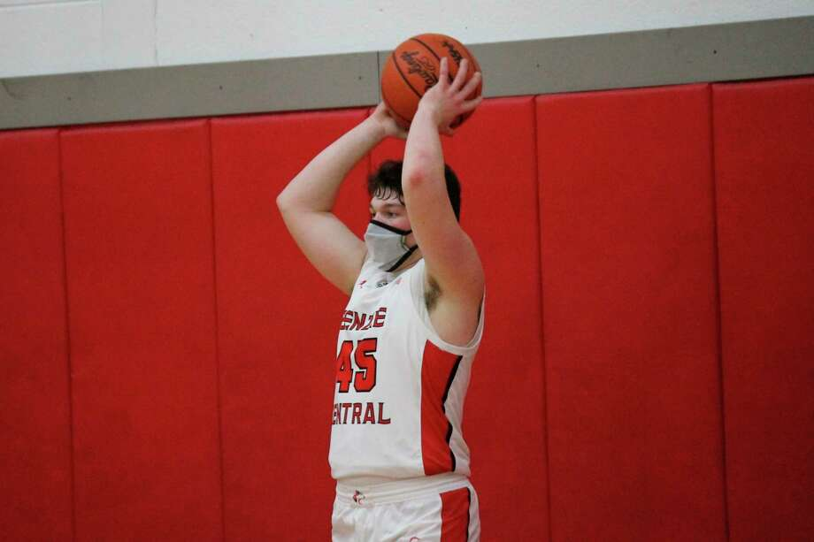 Benzie Central's Quinn Zickert prepares in inbound the basketball during a game against Kingsley on Feb. 11. (Record Patriot file photo)