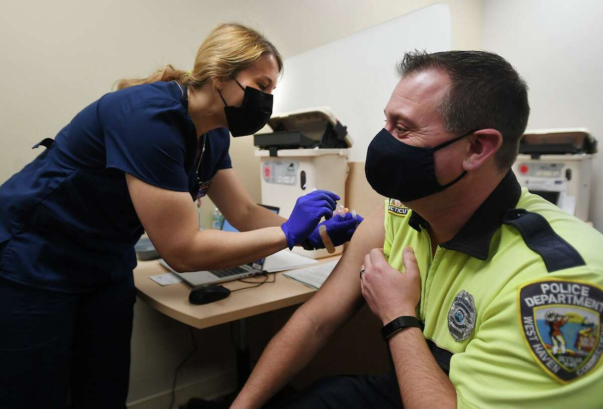 West Haven police Officer Doug Bauman gets his Covid-19 vaccine at Griffin Health's vaccination center in Shelton, Conn. on Tuesday, February 16, 2021.