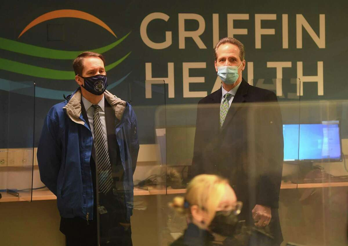 U.S. Rep. Jim Himes, left, takes a tour of Griffin Health's vaccination center with company President/CEO Patrick Charmel in Shelton, Conn. on Tuesday, February 16, 2021.