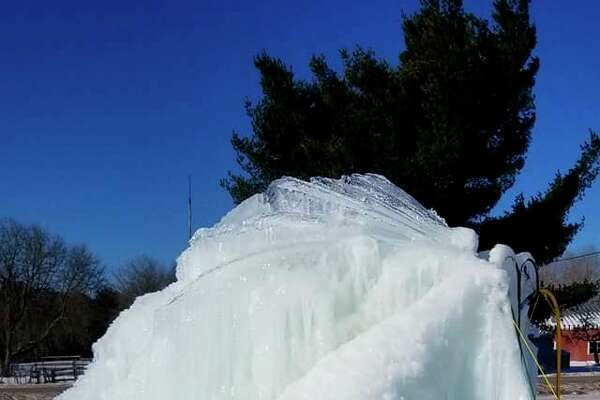 Evart resident Linda Brazelton creates a iceberg in her yard each year with a flowing well. This year, the iceberg has grown to about 10 feet. (Courtesy photo)