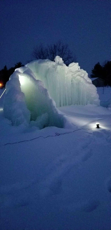Evart artist Linda Brazelton uses a light to illuminate the iceberg for cars driving past her house at night. (Courtesy photo)
