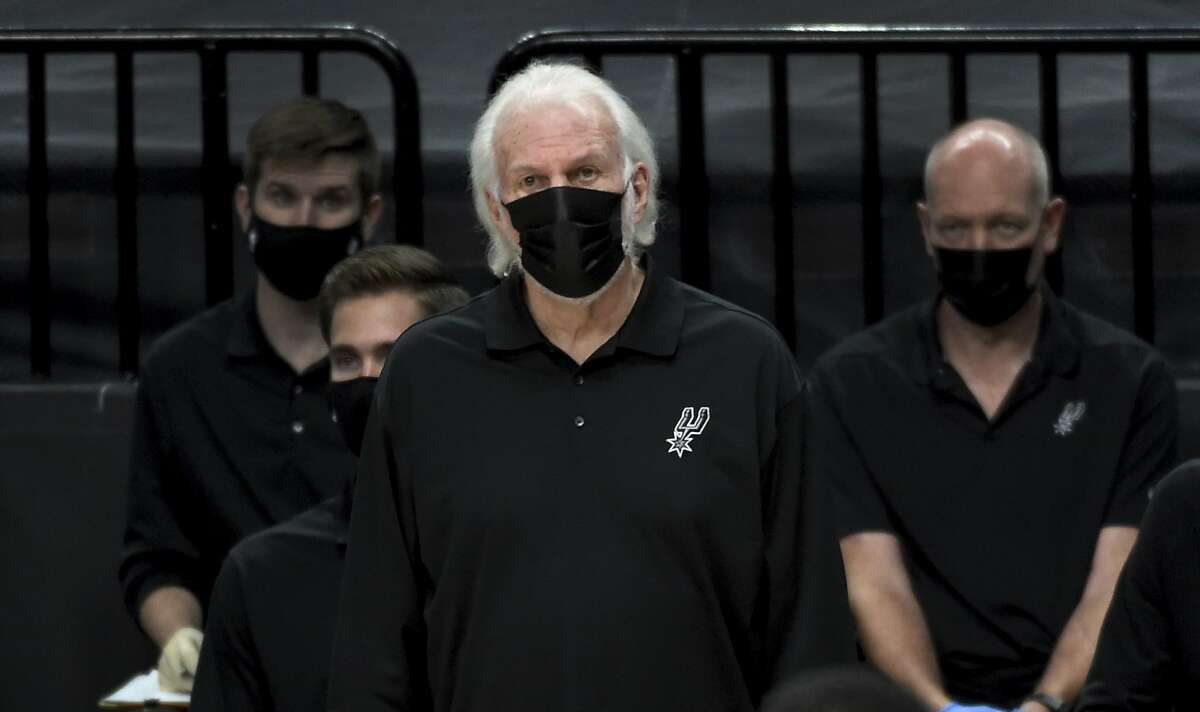 San Antonio Spurs head coach Gregg Popovich looks on from the bench during the second half of an NBA basketball game against the Portland Trail Blazers in Portland, Ore., Monday, Jan. 18, 2021. The Spurs won 125-104.