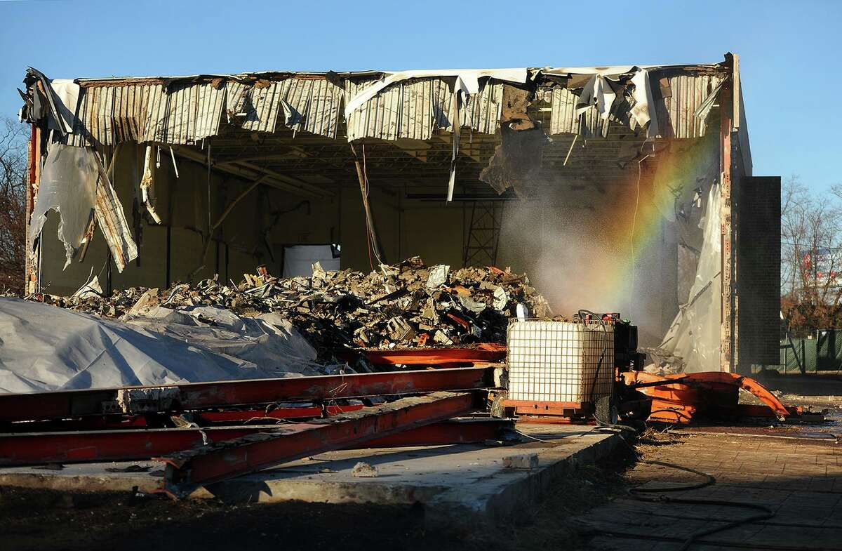 A rainbow forms in the mist used to keep down the dust during the demolition of the old Center School on Sutton Avenue in Stratford, Conn. on Tuesday, December 4, 2018.