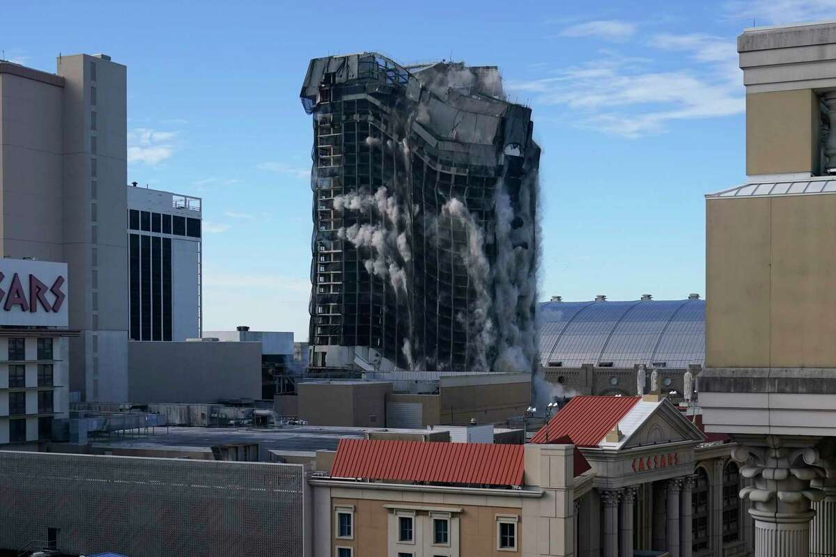The former Trump Plaza casino is imploded on Wednesday, Feb. 17, 2021, in Atlantic City, N.J. After falling into disrepair, the one-time jewel of former President Donald Trump's casino empire is reduced to rubble, clearing the way for a prime development opportunity on the middle of the Boardwalk, where the Plaza used to market itself as