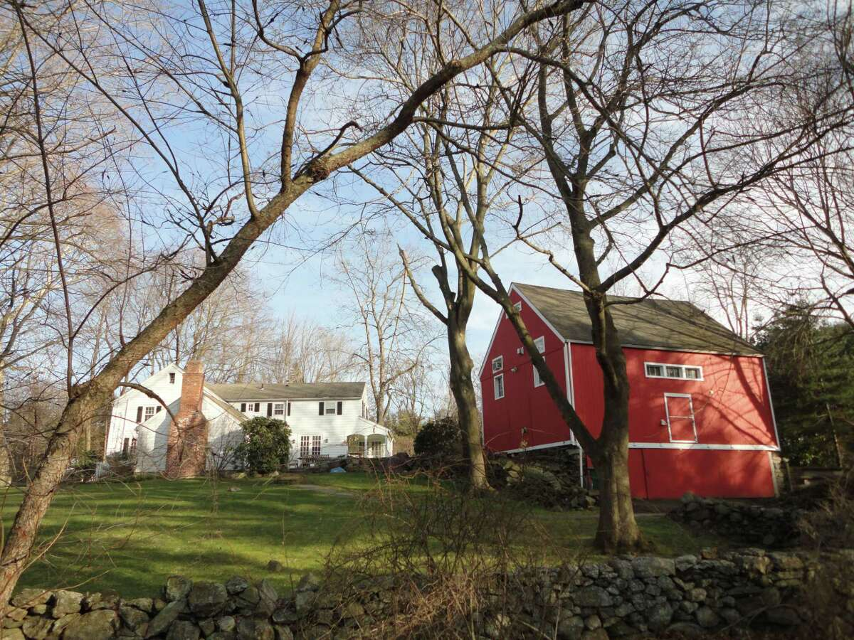 View of the historic saltbox and barn at 108 Cross Highway. The house was built in 1806 by a free Black man and it is included on Connecticut's Freedom Trail.