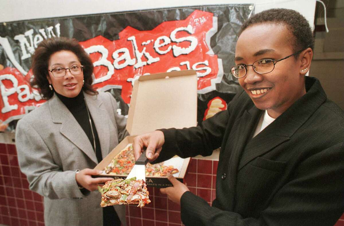 Times Union staff photography by MICHAEL P. FARRELL -- MONDAY, NOVEMBER 24, 1997 -- ALBANY, NY -- KELLI GIVENS , COO AND CAROLE RILEY, CEO of the owners of The Horizon Collective , an African-American owned operator of 44 Pizza Huts in upstate New York and western Massachusetts were on hand to announce the first of the year opening of a pizza Hut on South Perl ST. in Albany , Monday.