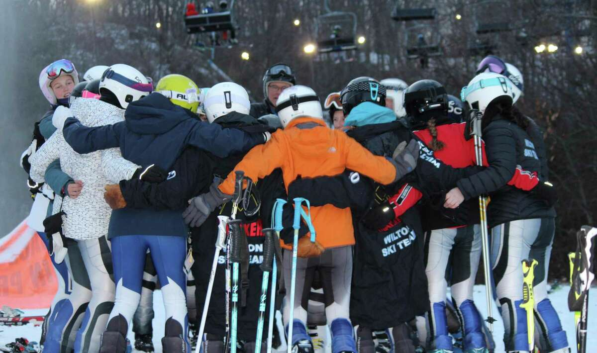 The Wilton girls ski team, pictured from last season, earned a first-place team finish at the CISL Class S season-opening race last week. Eight of it's team members finished in the top 12.