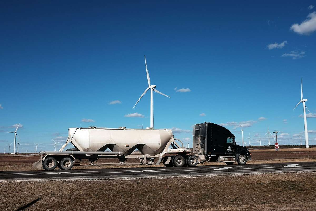 Wind turbines are viewed at a wind farm on January 21, 2016 in Colorado City, Texas.
