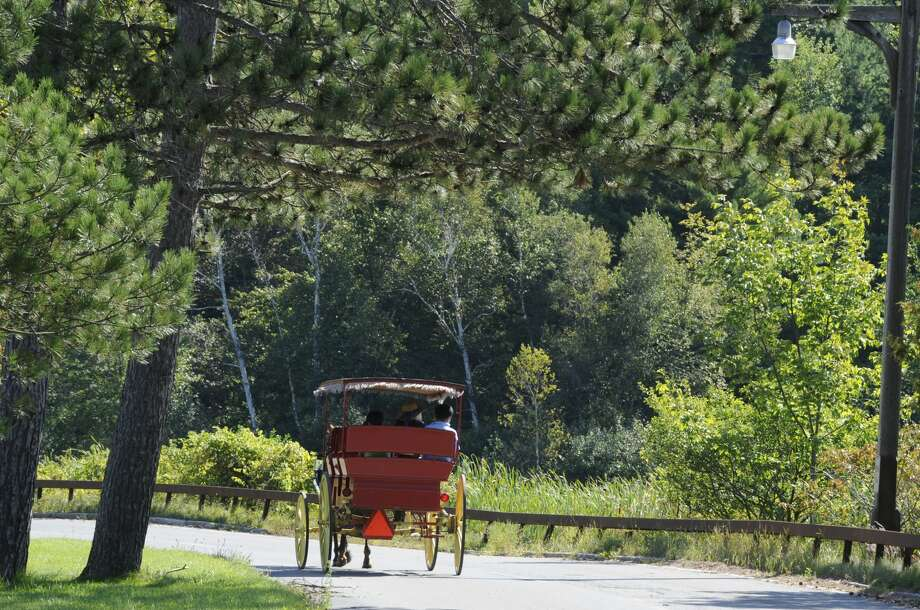 A horse and carriage bring tourists around Lake George Village, N.Y. Aug 30, 2011. (Skip Dickstein/ Times Union) Photo: Skip Dickstein/Albany Times Union