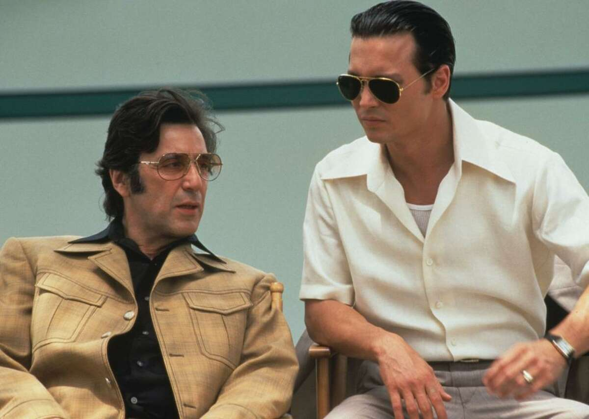 """#100. Donnie Brasco (1997) - Director: Mike Newell - Stacker score: 83.6 - Metascore: 76 - IMDb user rating: 7.7 - Runtime: 127 minutes Undercover FBI agent Donnie Brasco (real name Joseph D. Pistone) infiltrates the legendary Bonanno crime family in 1970s New York City in this true crime drama. Starring Al Pacino and Johnny Depp, the film was based on Pistone's book, """"Donnie Brasco: My Undercover Life in the Mafia."""" It's believed that Pistone's long career as an undercover agent generated over 200 indictments and 100 convictions of Mafia members."""