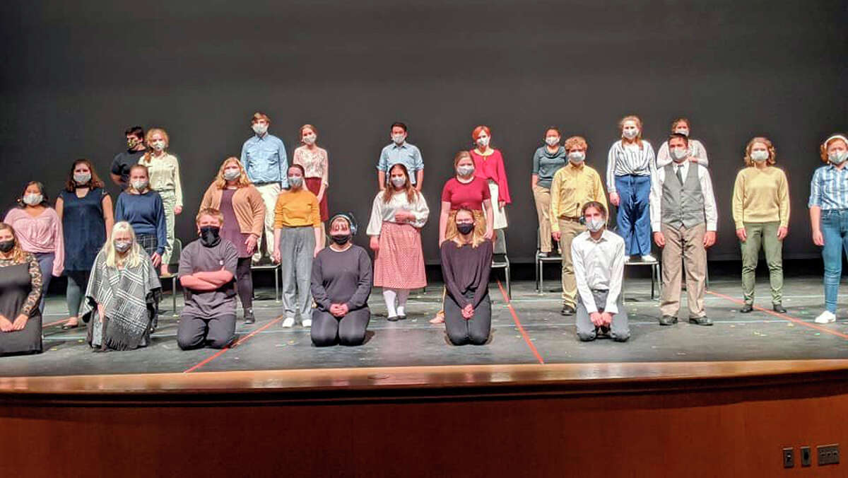 Cast members pose during practice for their upcomingwinterperformances. For seniors, it will be their second to last show before graduating.