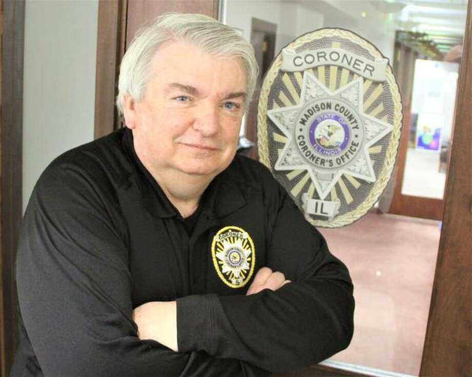 Madison County Chief Deputy Coroner Roger Smith will retire March 12, after 38 years of public service in law enforcement and emergency services. Smith joined the Coroner's Office in 1989 as a full-time investigator, and was named chief deputy in 2010. Photo: Scott Cousins | Hearst Illinois