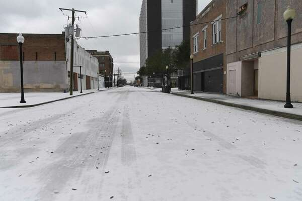 Downtownn Beaumont was deserted early Monday morning as Southeast Texans awoke to frigid temperatures and iced cars and roadways after the arctic front moved in overnight. Photo taken Monday, February 15, 2021 Kim Brent/The Enterprise