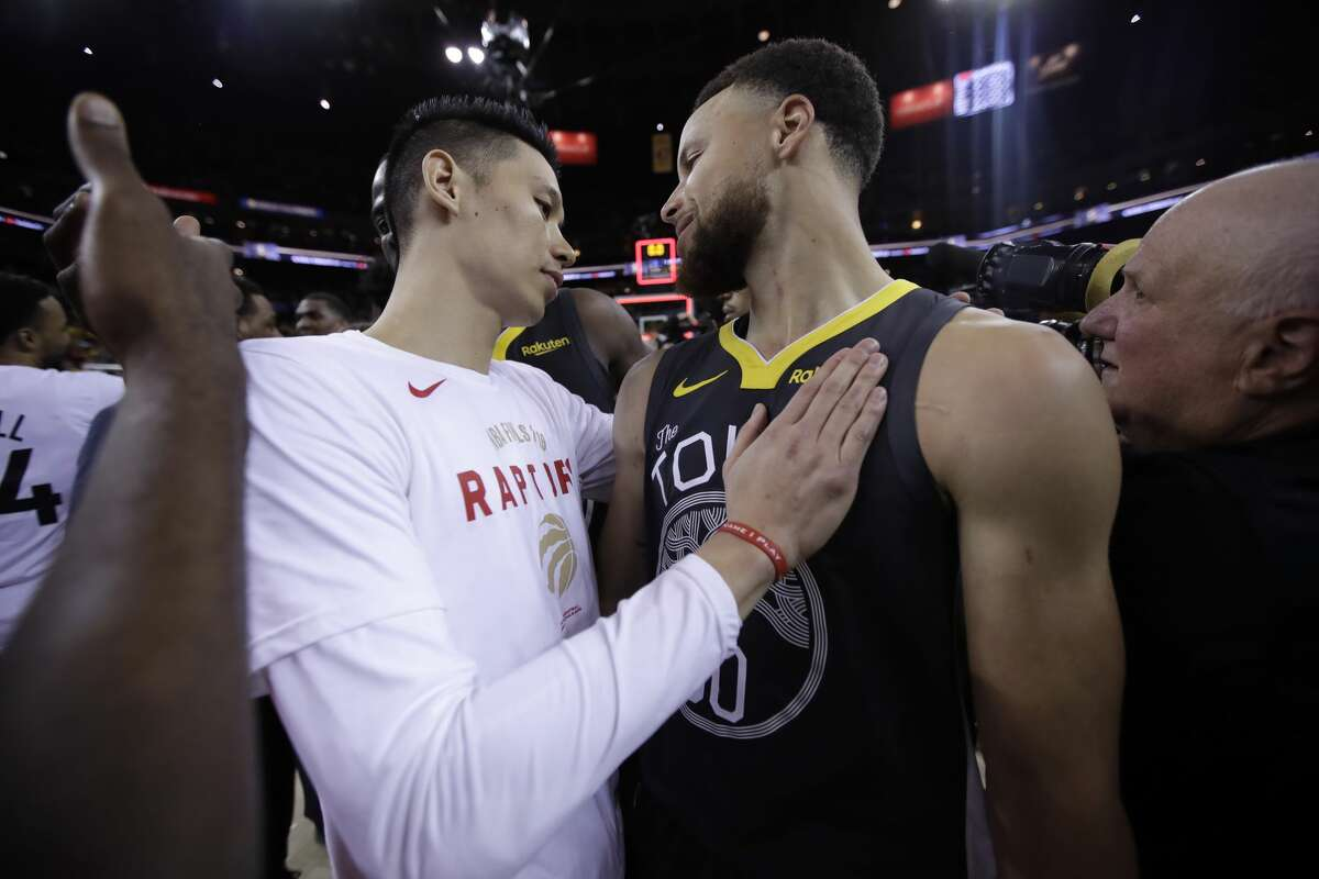 Toronto Raptors guard Jeremy Lin greets Golden State Warriors guard Stephen Curry after the Raptors defeated the Golden State Warriors in Game 6 of the 2019 NBA Finals.
