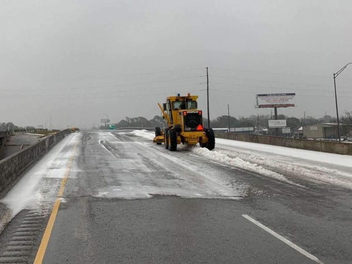 Texas Dept. of Transportation crew removing ice and snow from roads and bridges. This photo was taken on Groves SH73