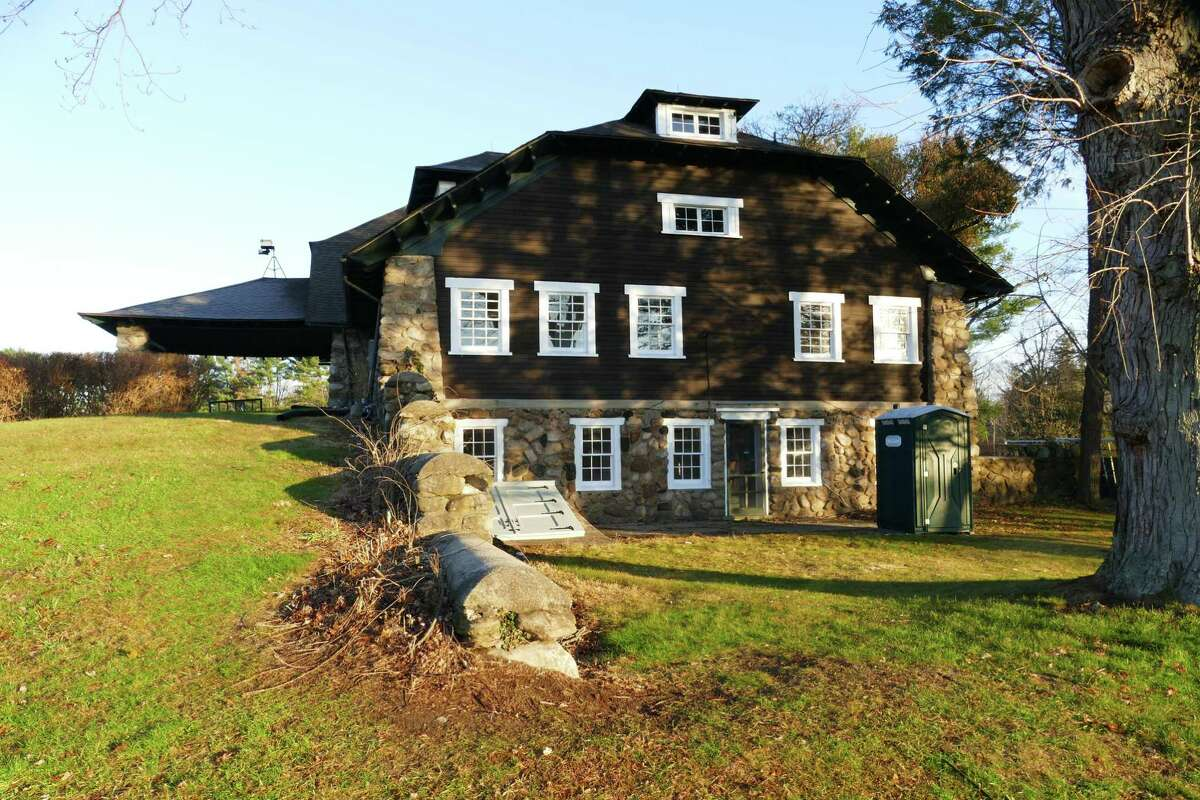 New Canaan's Irwin Barn, built of stone and wood in the late 1800s and early 1900s got refurbished windows. The Town budgeted $132,000 for repairs to the barn in the 2018-'19 capital budget. There had been a budget discussion about spending $50,000 for putting public bathrooms on the lower floor, but that was taken out before the budget was passed - hence the outdoor restroom.