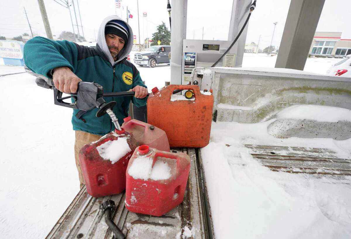 Steven Bureau of Magnolia fills gas cans at a station along State Highway 249 Monday, Feb. 15, 2021 in Tomball.
