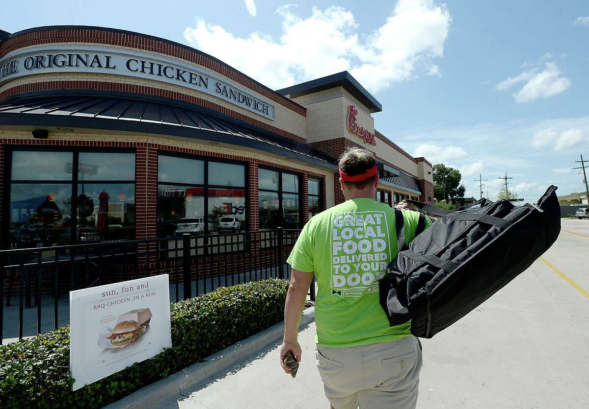 Donny Avery makes his way into Chick-fil-a to pick up a customer order while spending his Saturday driving for Waitr. It is among the side jobs that Avery has in addition to his full time job at the Regional Visitor's Center. Photo taken Friday, August 11, 2017.