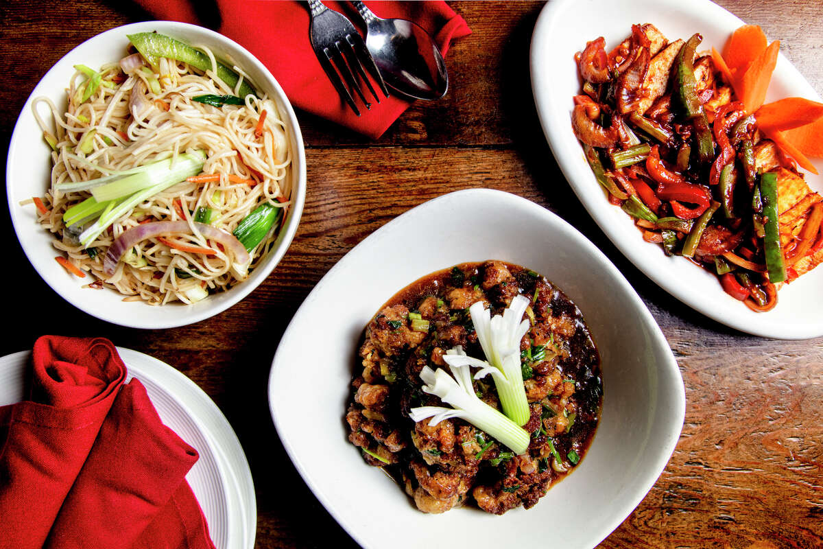 A few featured dishes of Red Hot Chilli Pepper restaurant in San Carlos, Hakka noodles, left, gobi manchurian, center, and spicy paneer, right.