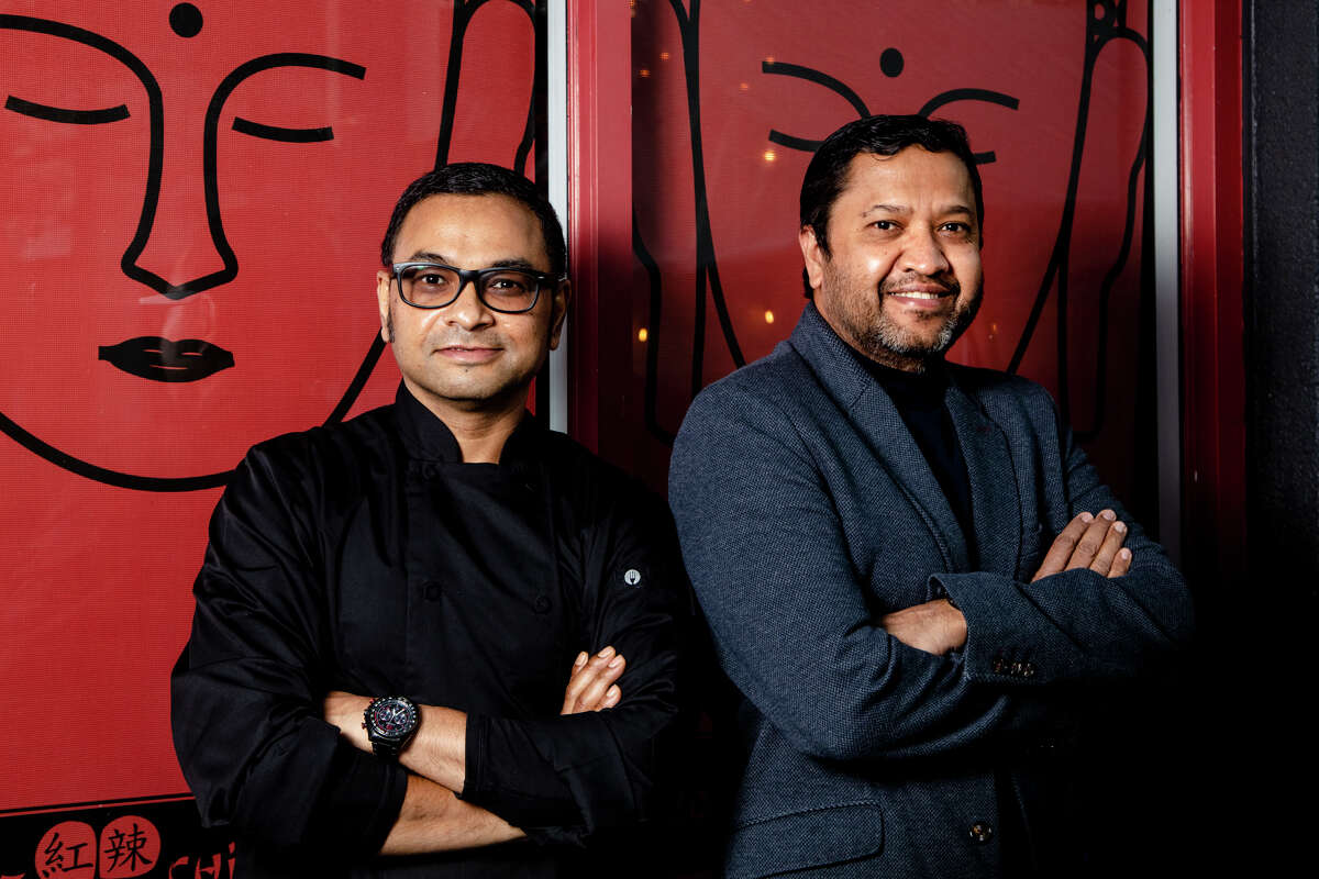 Chef Bharat Dhamala, left, and owner Snehal Patel, right, of Red Hot Chilli Pepper restaurant in San Carlos.
