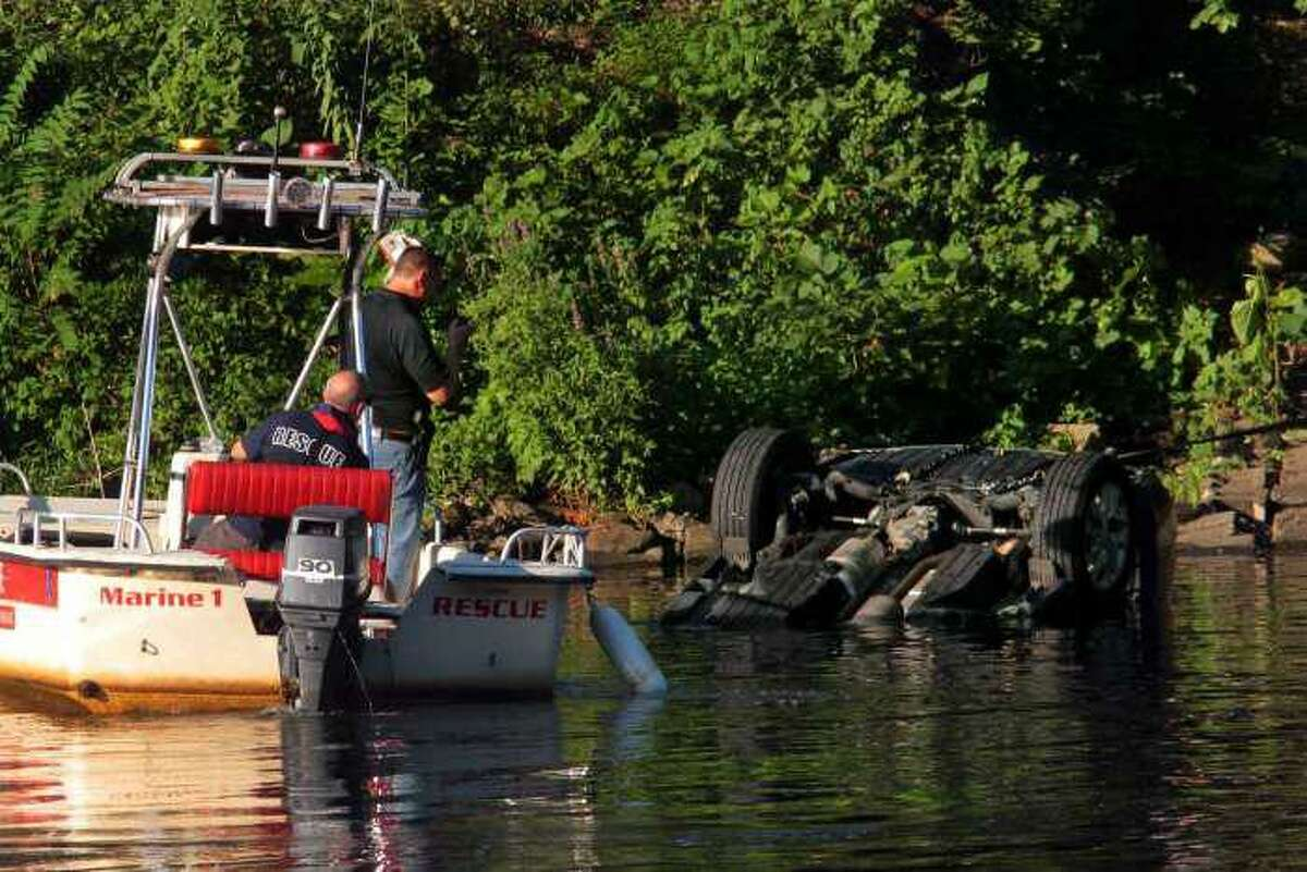 Officials investigating after a vehicle was driven in to the Housatonic River in Seymour, Conn., on Friday, July 31, 2020.