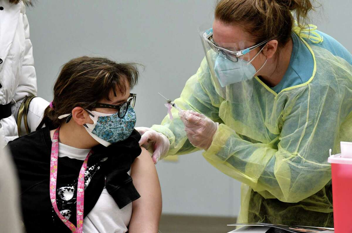Nina Maddalla receives her COVID-19 vaccine injection during a vaccination clinic on Wednesday, Feb. 17, 2021, at the Center for Disability Services in Albany, N.Y. Albany County and Albany Medical Center, with the approval of the New York State Health Department, allocated 450 dosages of the Moderna COVID-19 vaccine to be administered to people who live in groups homes for persons with intellectual and developmental disabilities, as well as workers who care for them. (Will Waldron/Times Union)