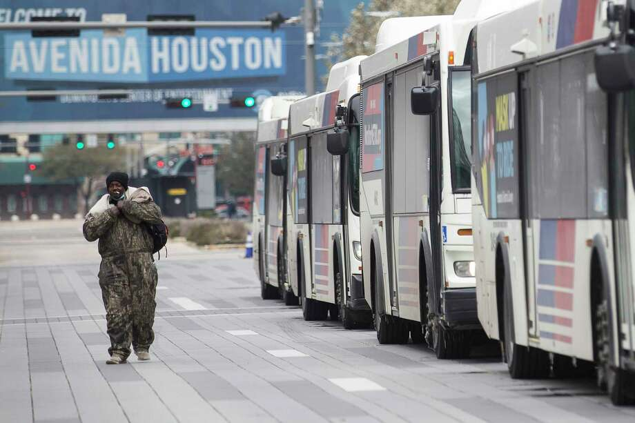 A line of Metro busses are staged outside the George R. Brown Convention Center to transport people seeking shelter from the frigid temperatures to a shelter Tuesday, Feb. 16, 2021 in Houston. Temperatures stayed below freezing Tuesday, with many still without power. The GRB is being used as a warming shelter, but it is filled to capacity, forcing the need for additional shelters around the city. Photo: Brett Coomer, Houston Chronicle / Staff Photographer / © 2021 Houston Chronicle