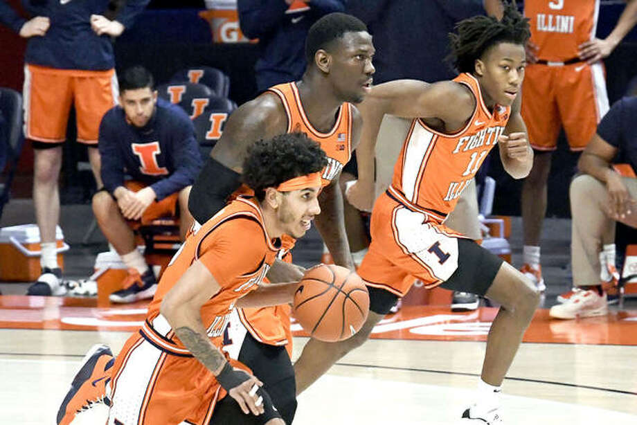 Illinois guard Andre Curbelo (5) center Kofi Cockburn (21) and guard Ayo Dosunmu (11) bring the ball upcourt against Northwestern Tuesday night in Champaign. Photo: Holly Hart | Associated Press
