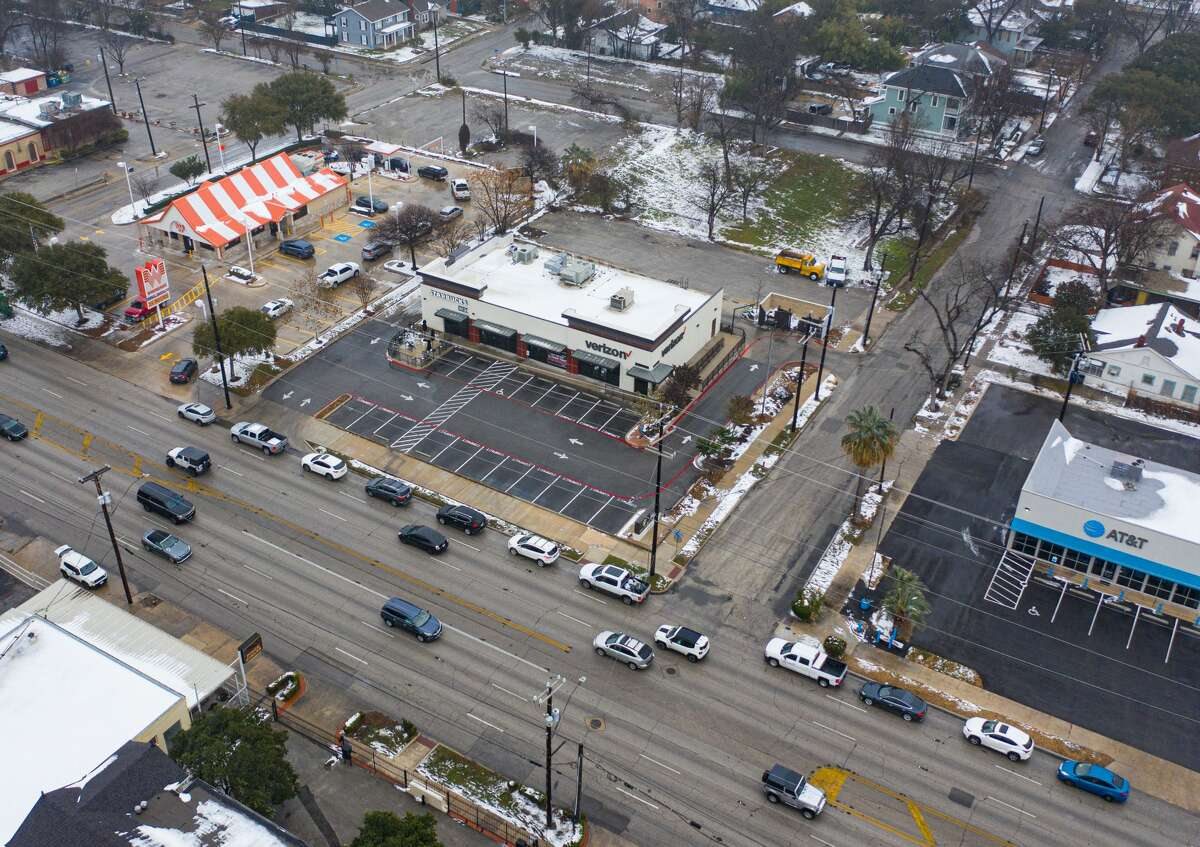 Despite the icy road conditions in the city, drone shots from local photographer Paul DiGiovanni show a long line formed around the Whataburger location on Broadway, near Mulberry, early Wednesday morning.