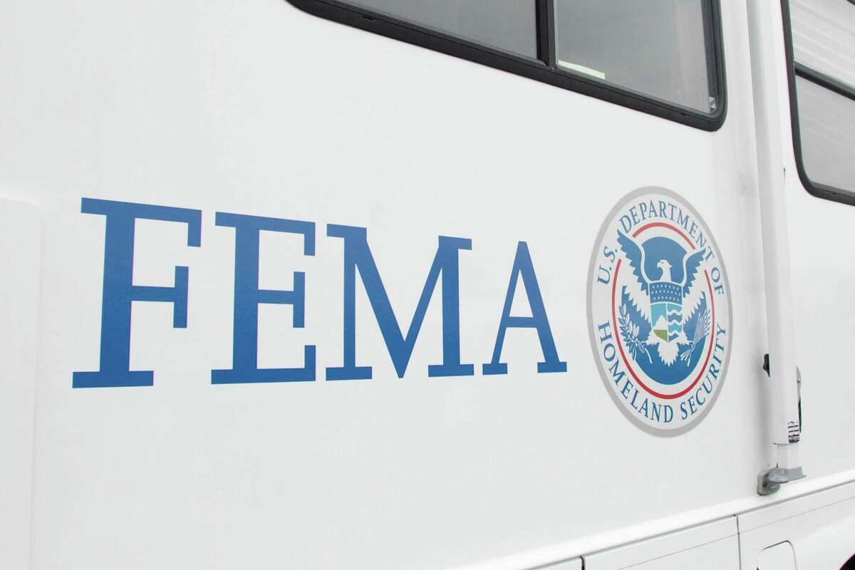 A FEMA (Federal Emergency Management Authority) trailer sits at the COVID-19 mass vaccination site opened to the public at the Oakland-Alameda Coliseum Complex in Oakland, Calif. on Feb. 16, 2021. The federal government is sending generators, water and blankets to Texas and is preparing to ship in diesel, as well, to help with backup power, the White House announced on Feb. 17, 2021