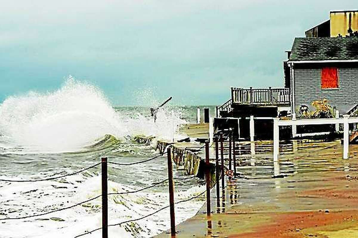 Superstorm Sandy picks up speed as waves from Long Island sound hit beach in East Haven in 2012.